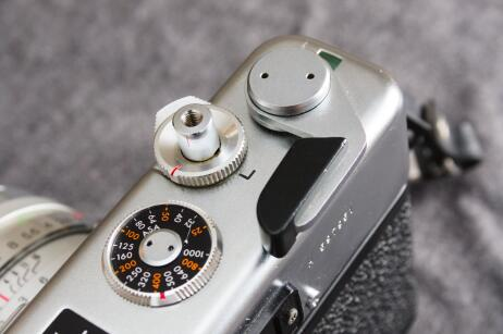 The film advance lever, ISO dial, shutter release, and the shutter lock